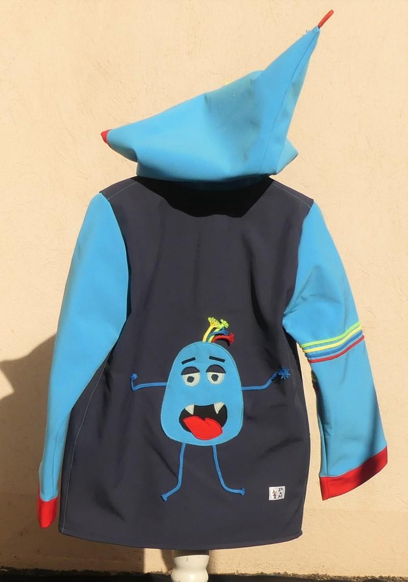 Veste lutin déperlante en softshell bleu fonce et turquoise avec «monstre rigolo»